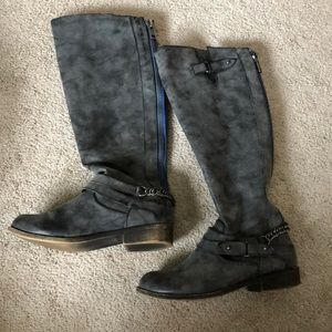 Gray, zip up riding boots.